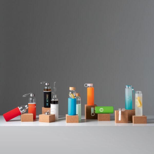 Botellas de vidrio y funda de neopreno